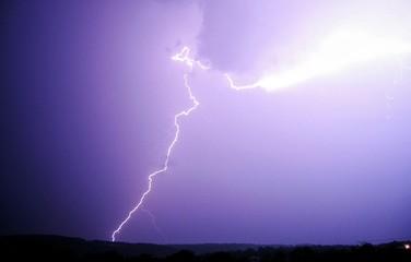 Foto auf Gartenposter Flieder Low Angle View Of Lightning On Silhouette Landscape