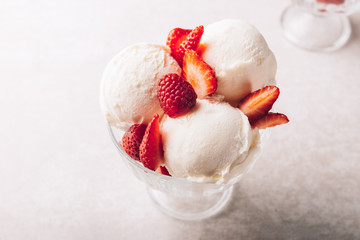 Vanilla Ice Cream Scoops with strawberry pieces, easy dessert at home
