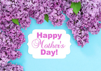 Foto auf Leinwand Flieder Lilac flowers blue background Happy Mothers Day