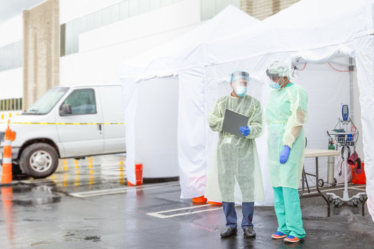 Frontline Epidemic Medical providers in Protective Gear Caring for Patients.