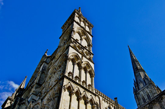 View up at West Front and Spire, Cathedral Church of the Salisbury diocese, Salisbury, England