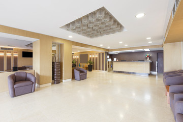 Empty interior of hotel hall with reception desk. Fotomurales