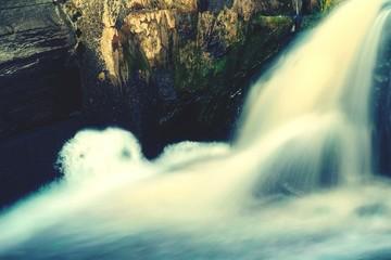 Foto op Plexiglas Oranje Blurred Motion Of Waterfall