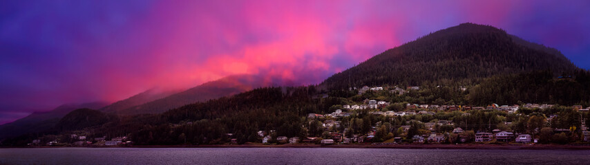 Wall Mural - Beautiful Panoramic view of a small town, Juneau, during a cloudy morning with mountains in the background. Taken in Alaska, United States. Colorful Artistic Sky Composite