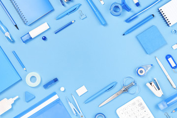 Assorted office and school white and blue stationery on pastel trendy background as border. Flat...