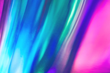 Wall Mural - Blurred texture in violet, pink and mint colors. Abstract trendy holographic background in 80s style. Synthwave. Vaporwave style. Retrowave, retro futurism, webpunk