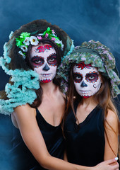 Day of The Dead girls. Dia de los muertos. Halloween costume and make-up.