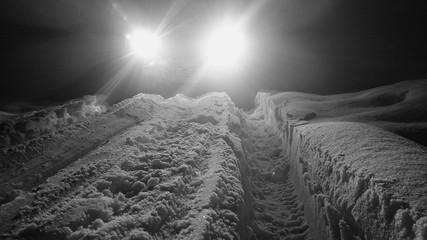 Fototapeten Grau Tire Tracks In Snowy Landscape
