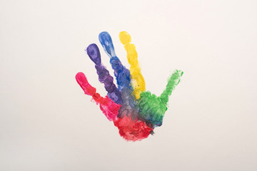 top view of colorful handprint on white for World Autism Awareness Day