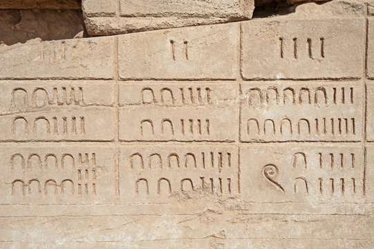 Hieroglyphic numerical carvings on an ancient egyptian temple wall