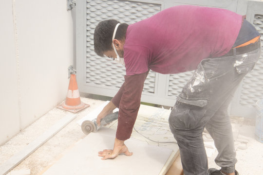 Man working in a building site with the mask for covid
