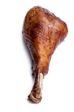 Roasted turkey leg isolated on white