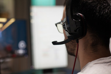 Close up concentrated man playing professional shooter games. Esports streaming.