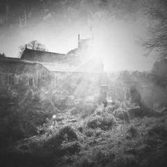 Fototapeten Grau Sunlight Falling On Landscape And Hambledon Church