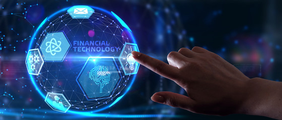Fintech -financial technology concept.Young businessman  select the icon Fintech on the virtual display.