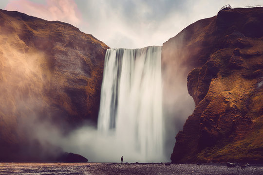 Amazing Icelandic Landscape. Incredible view of famous Skogafoss waterfall during sunset. Dramatic Scenery of Iceland. Skogafoss Waterfall. Iceland the most beautiful and best travel place. postcard