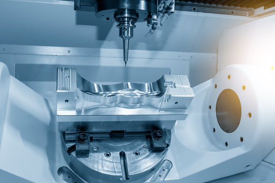 The  5 axis CNC milling machine cutting the  automotive mold parts with solid ball endmill tools. The hi-technology automotive part manufacturing process by 5 axis machining center.