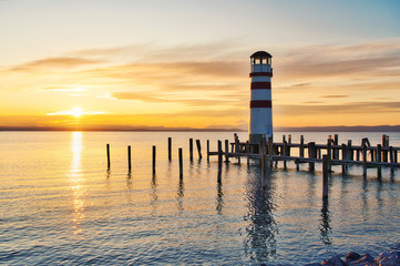 Scenic sunset at idyllic lake Neusiedlersee with old Podersdorf Leuchtturm lighthouse, Burgenland, Austria Fotomurales