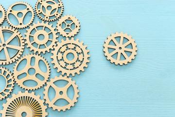 concept image of placing a cogwheel in set of gears mechanism
