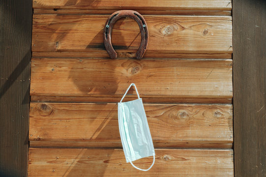 Mask is hanging with horseshoe