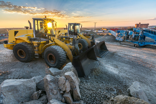 Group of excavators at a construction site