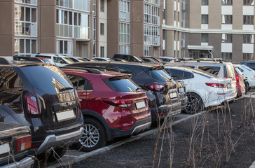 Cars parked in the courtyard of a residential building