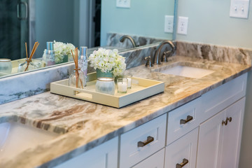 Clean and modern new construction home house bathroom with granite countertops and a tile floor and double sinks