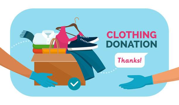 Volunteer giving clothing donation box
