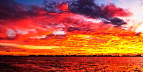 Keuken foto achterwand Rood fire in the sky, sunset, sky, sea, clouds, red, yellow, intense, colorful, landscape, skyline, cityscape