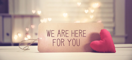 We are Here for You message with a red heart with heart shaped lights