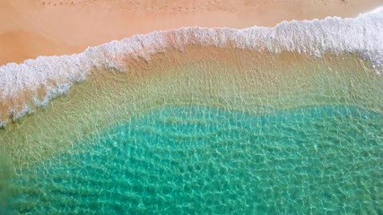 Wall Mural - Tropical beach on Oahu island in Hawaii. Top down view of the perfect sandy beach with gentle rolling waves
