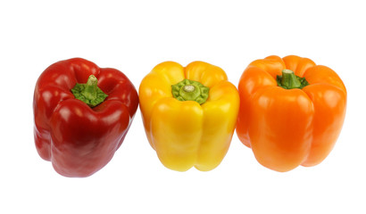 Wall Mural - close up on fresh colorful peppers isolated on white background