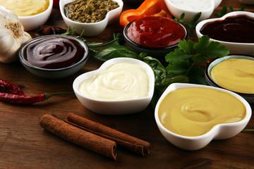 Sauces Assortment. Set of various sauces in bowls with ketchup, mayonnaise, pesto and mustard. Variety of induvidual marinades.