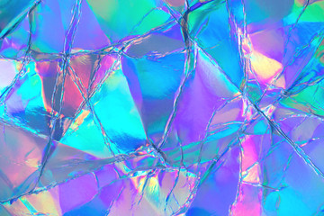 Wall Mural - Blurred abstract Modern pastel colored holographic background in 80s style. Crumpled iridescent foil real texture. Synthwave. Vaporwave style. Retrowave, retro futurism, webpunk