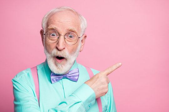 Closeup photo of cool aged man open mouth indicate fingers empty space black friday prices wear specs mint shirt suspenders bow tie isolated bright pink pastel color background