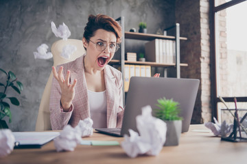 Close-up portrait of nice attractive crazy outraged lady ceo boss chief throwing documents screaming looking at screen at modern industrial concrete wall brick style interior workplace workstation