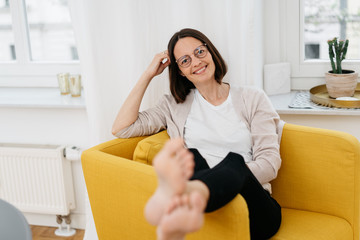 Attractive middle-aged woman relaxing at home