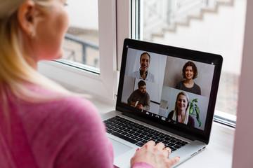 Fototapeta Woman Working From Home Having Group Videoconference On Laptop obraz