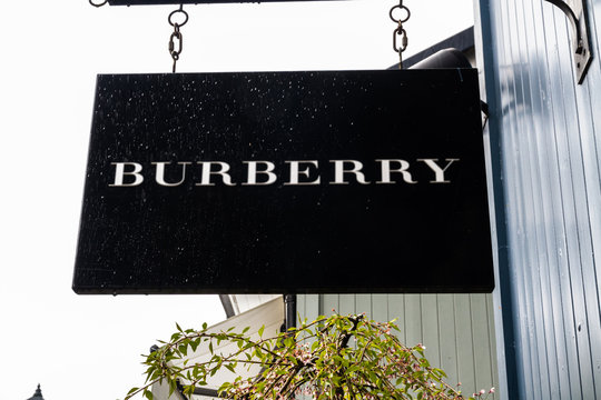 Editorial, Sign or logo of Burberry on hanging sign