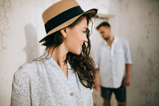 Portrait of a young woman in a hat with her boyfriend