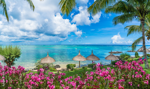 Wall mural Public beach with lounge chairs and umbrellas in Pointe aux Canonniers, Mauritius island, Africa