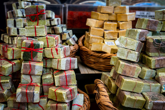 Natural Laurel soaps lined up like walls waiting to be sold