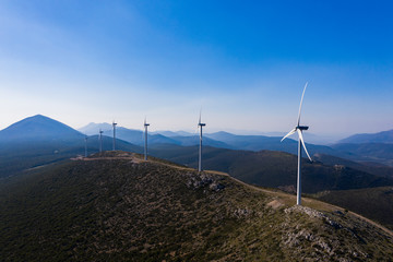 Windmill farm in Greece. Wind energy on mountains view