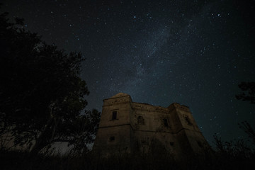 Milky way with medieval castle in the background