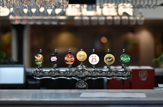 Copenhagen / Denmark - 07.26.19: Beer taps on pab bar. Trade marks Grimbergen, Kronenbourg, Carlsberg and Tuborg.