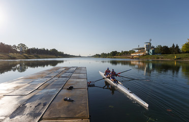 Sinkovic brothers push boat from shore as they start with the training at Zagreb's lake Jarun