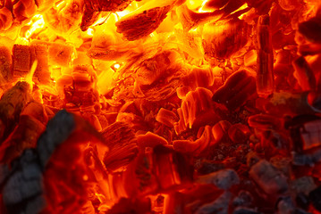 red hot coals in a blast furnace for metal melting. metal mining and processing industry. Red coals from a burnt fire made of wood