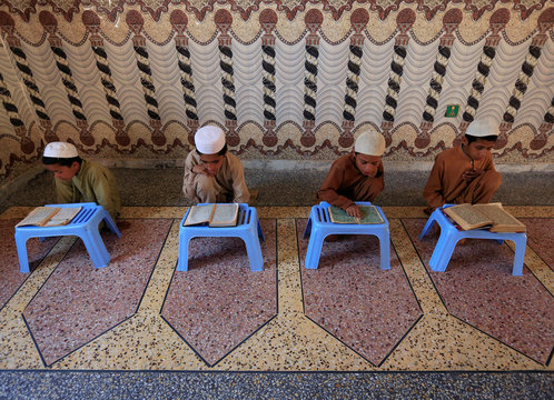 Afghan boys read the Koran at a mosque during the holy month of Ramadan, amid the spread of the coronavirus disease (COVID-19), in Jalalabad