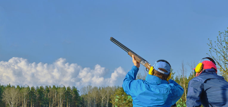 man trap shooting, classic double-barreled shotgun for clay pigeon hunting, panoramic banner , Images with Copy Space