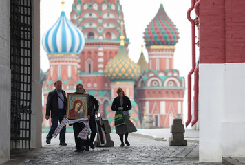 A man carries an icon in central Moscow